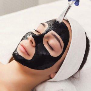 woman-gets-face-mask-by-beautician-at-spa-PZBNAZJ-1024x683